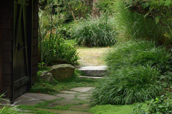 Cottage garden deer resistant stone path British Columbia Bowen Island design Stephen Stewart